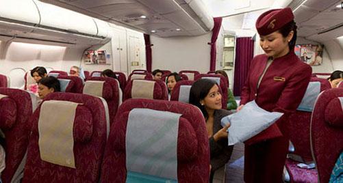 how to change qatar airways flight date